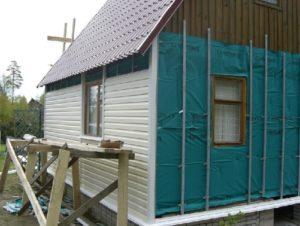 Обшивка деревянного дома профнастилом своими руками
